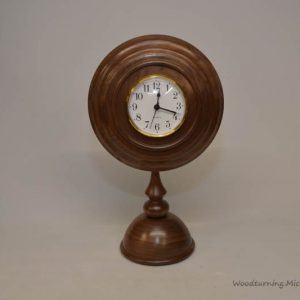 Walnut pedestal clock